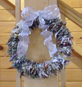 Christmas wreath made from crafting scrap fabric pieces.