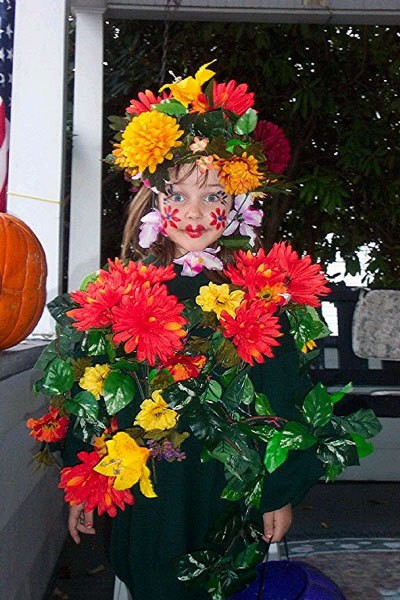 Little girl dressed as a flower garden.