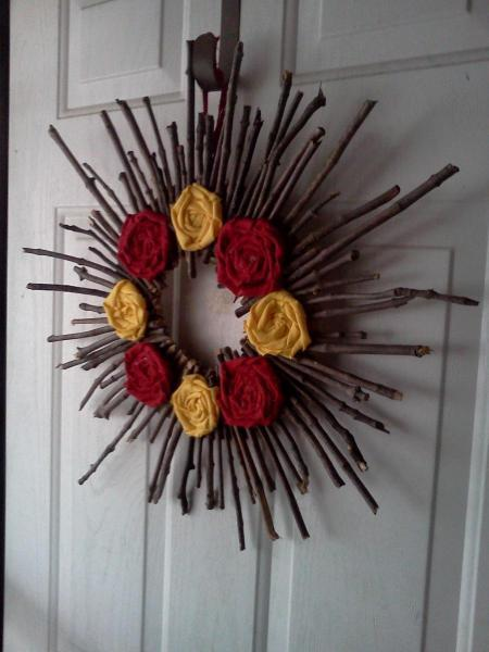 Stick wreath hanging on the front door.