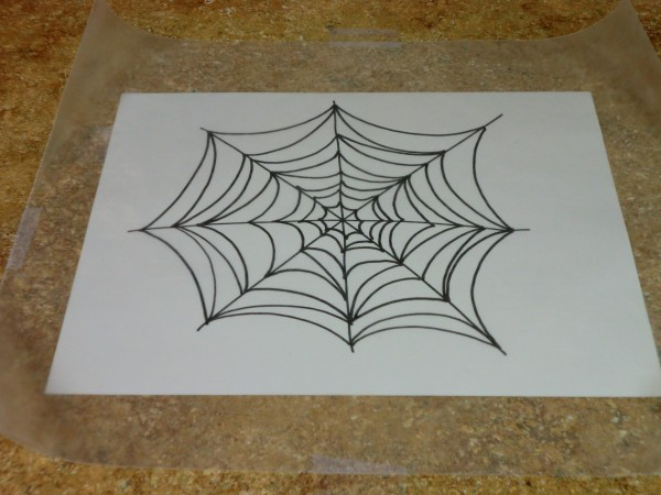Making a glitter glue spiderweb thriftyfun for Drawing on wax paper