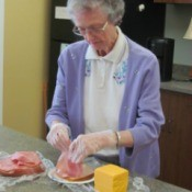 A photo of Wava working with food in the kitchen.