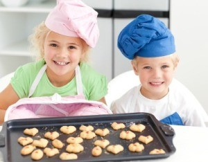 Young Boy and Girl Baking Cookies