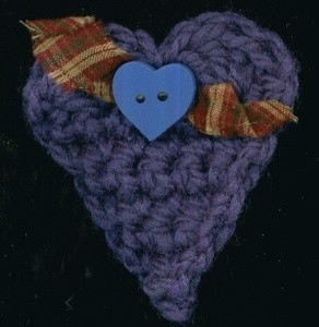 Blue crochet heart shaped ornament.