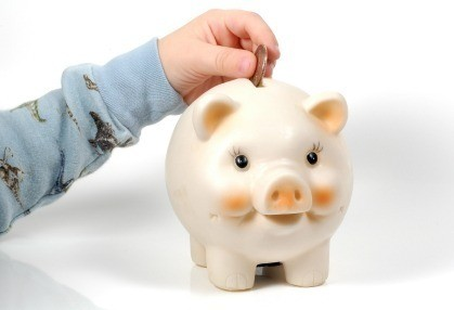 Saving Money in Piggy Bank