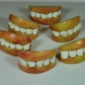 Halloween treat made with apple slices and marshmallows made to look like lips and teeth.