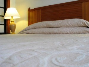 Photo of a bed with a memory foam mattress.