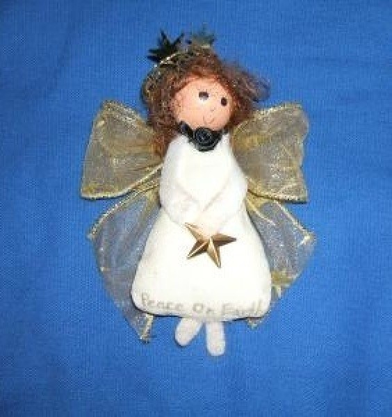 Cute white kitchen angel with gold ribbon wings.
