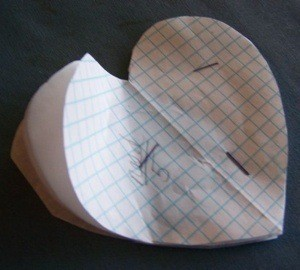 Paper heart shape stapled together.