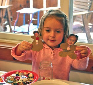 Child holding the finished gingerbread people.