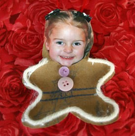 Child's photo attached to gingerbread cutout.