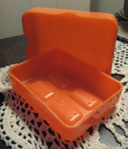 Hard plastic travel soap case.