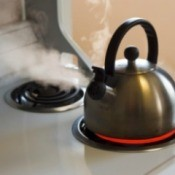 A tea kettle on a stovetop.
