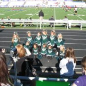 Little cheerleaders at football game.
