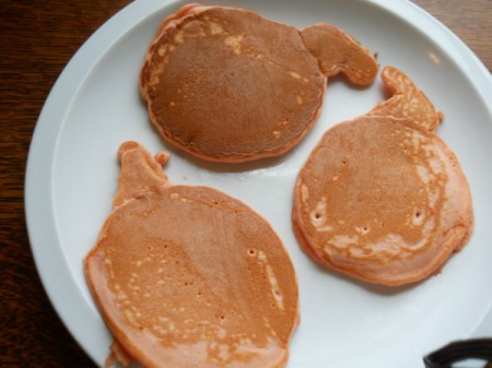 Pumpkin pancakes on plate.