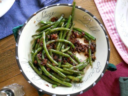 Sautéed fresh green beans with onions and soy sauce.
