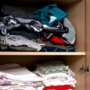 Clothing stored in a closet.