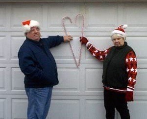 A couple making a heart with two candy canes