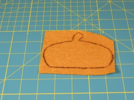 Tracing of acorn cap on felt square.