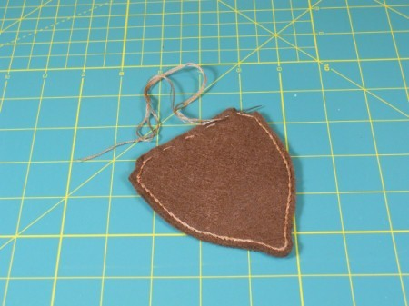 Sewing outline stitch on acorn.