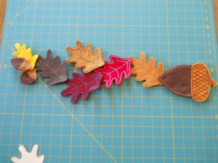 Creating pleasing arrangement of leaves and acorns.
