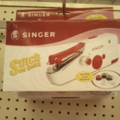 Singer hand held sewing machine.