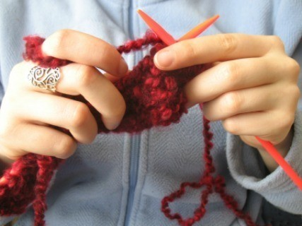 A woman holding yarn.