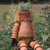 Recycled garden art. A man made from recycled clay pots.