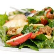 A healthy salad with light dressing on it.