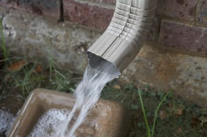 A rain downspout with runoff