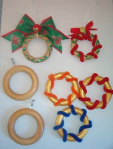 Shower curtain rings decorated as Christmas ornaments.