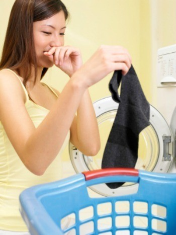 A girl cleaning stinky laundry.