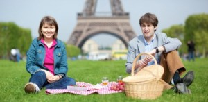 Two people at a picnic in Paris.