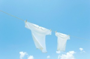 White t-shirts hanging on a clothesline.