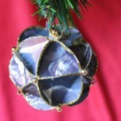 Faceted paper ornament made from recycled Christmas cards.
