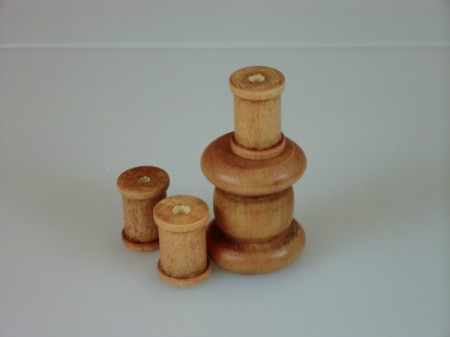 Stained wooden spools.