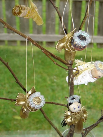 Angels hanging on a branch.