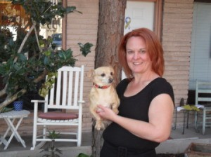 Woman holding small dog.