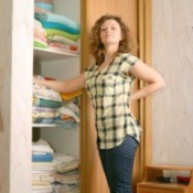 Woman With Organized Linen Closet