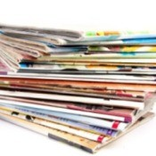 A large stack of food magazines.