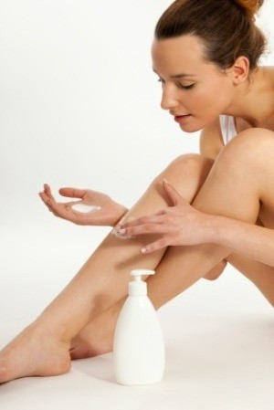 Woman Moisturizing Her Legs