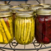 Canning jars of preserved vegetables