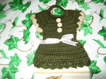 Crochet dress tea towel topper.