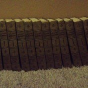 Set of encyclopedias on carpet.