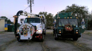 Trucks decorated for a Christmas parade