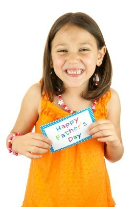 Girl with Homemade Father's Day Card