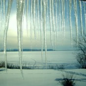 Snowy fields, frozen lake, and and icicles.