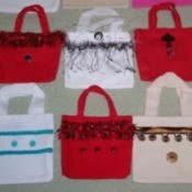 Red and white decorated mini tote bags.