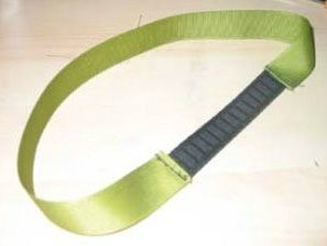 Green ribbon headband with elastic section.