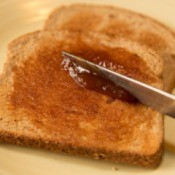 Apple Butter being Spread on Toast