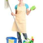 A woman with cleaning supplies.